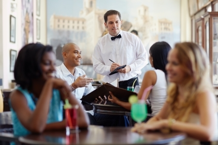 Waiter at Restaurant Taking Order