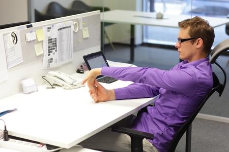 Man Exercising his Palms at Desk