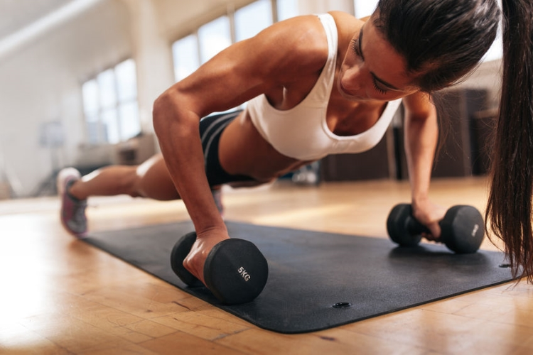 Woman Doing Pushups With Dumbells