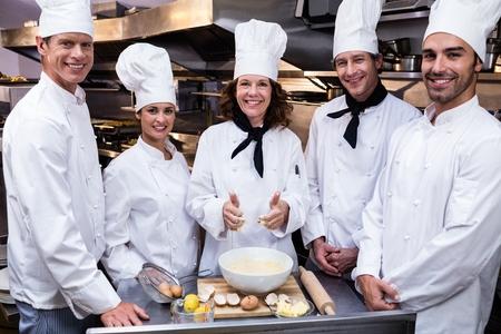 Chefs Standing in Kitchen