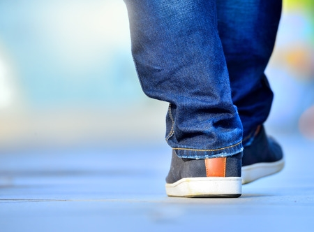 man walking with sneakers