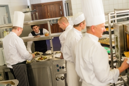 Cooks and Waiter in Kitchen