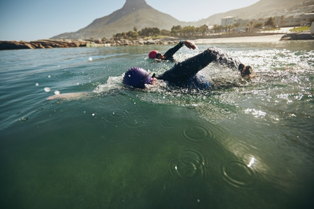 Swimmers Practising for Race