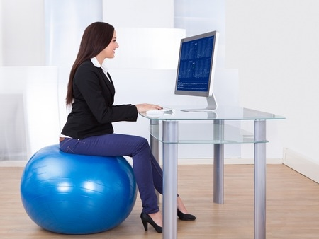 Using Laptop Sitting on Pilates Ball