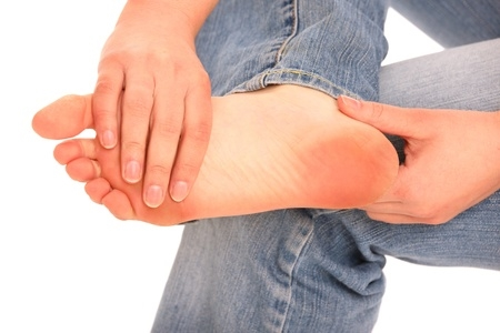 Man Holding Foot With Heel Pain