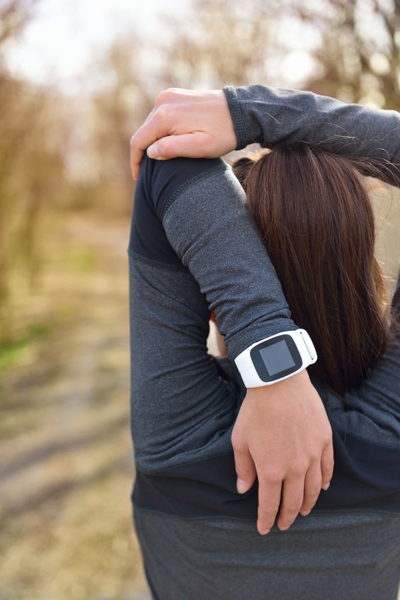 Woman With Activity Tracker Doing Cardio Workout
