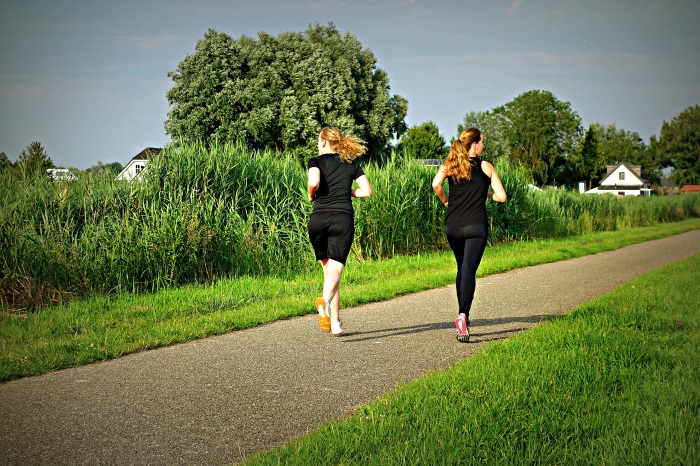 2 Women Running in the Countryside