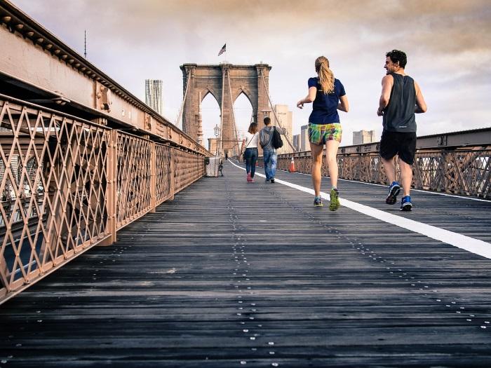 Couple Running on a Bridge