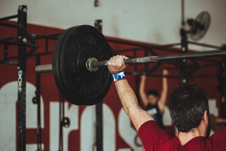 Man Lifting Barbell Above Head