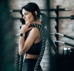 Woman Carrying Battle Ropes