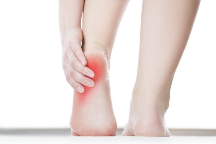 Clutching Painful Heel