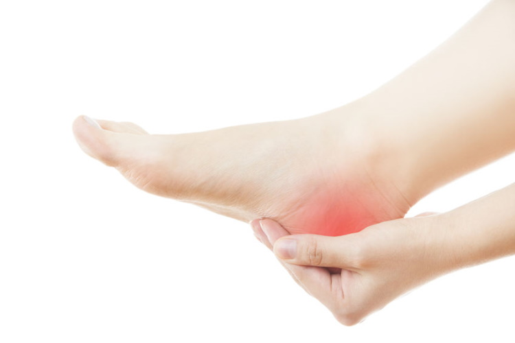 Hand Supporting Painful Heel