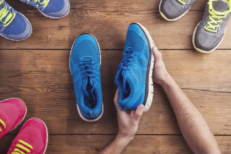 Runner Examining a Pair of Shoes