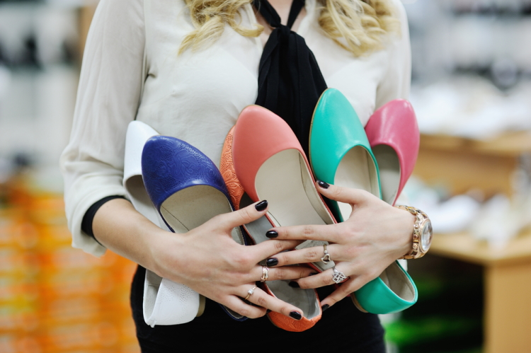 Female Holding Colorful Ballet Flats