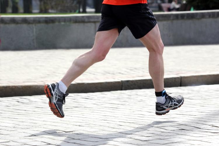 feet running athlete on a marathon distance