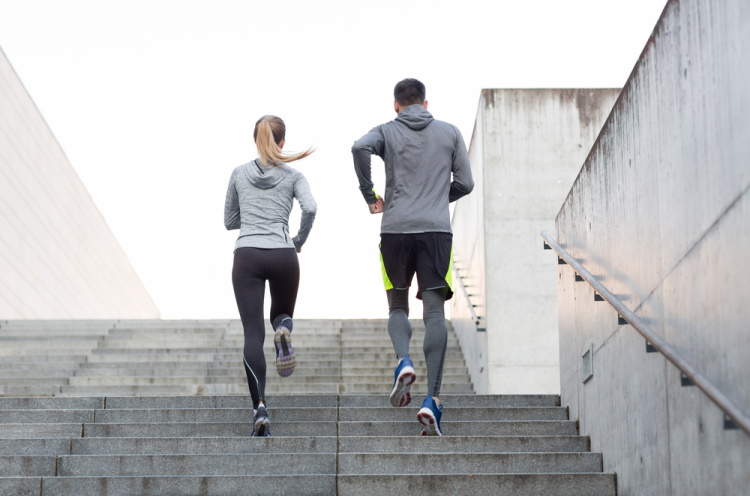 Couple Running on Stairs